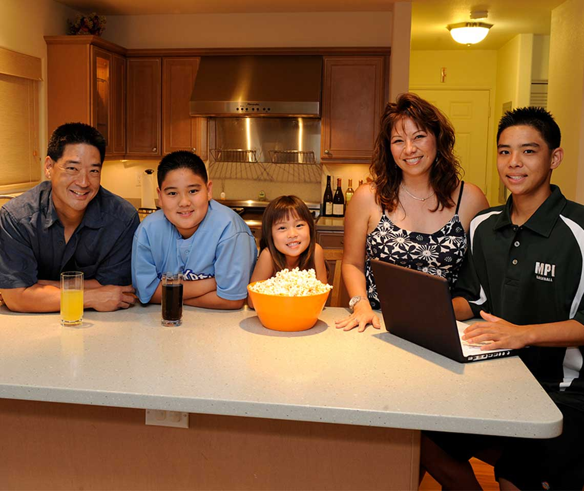 A-family-in-the-kitchen-smiling